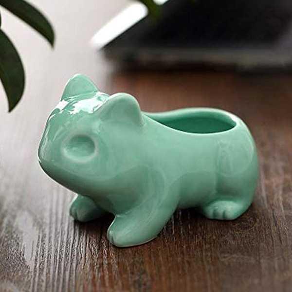 maceta de ceramica con forma del pokemon bulbasaur